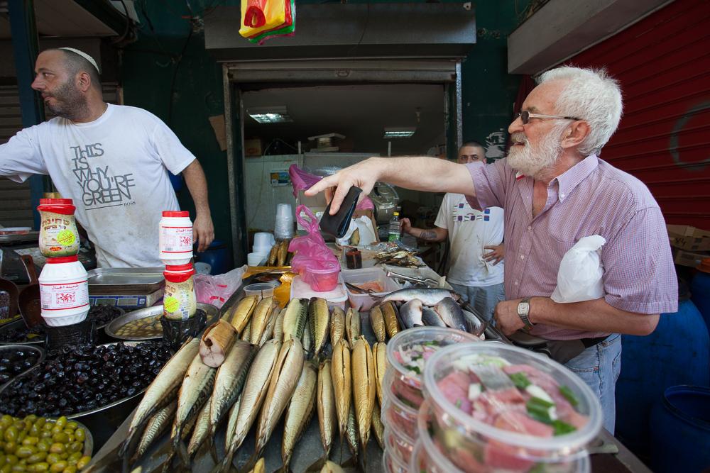 Fishy transactions, Carmel market, Tel Aviv, Israel