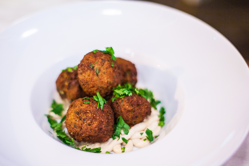 Cauliflower falafel on tahini sauce