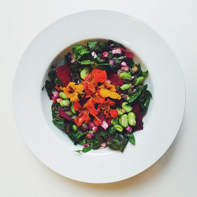 Broad beans week, raw salad. Broad beans, beetroot, spring onions, pumpkin seeds, chard, nasturtium flowers, cider vinegar, date syrup, extra virgin olive oil